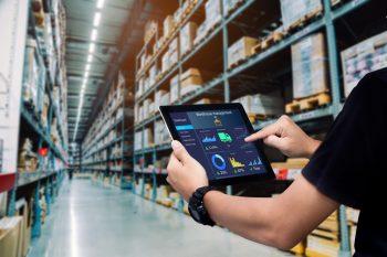 Smart,Warehouse,Management,System.worker,Hands,Holding,Tablet,On,Blurred,Warehouse